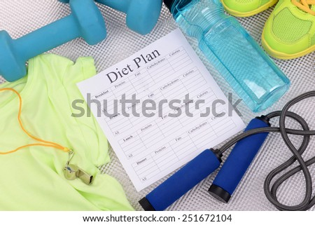 Diet plan and sports equipment top view close-up  - stock photo