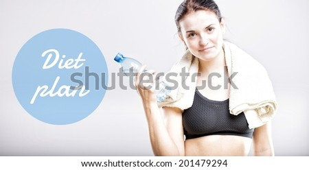 Diet plan, beautiful woman with bottle and towel - stock photo