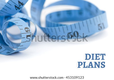 Diet plans, health concept, close up & selective focus of blue measuring tape, isolated on white background