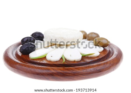 diet products : salted greek feta white cheese with olives and basil leaves sliced on wood isolated over white background - stock photo