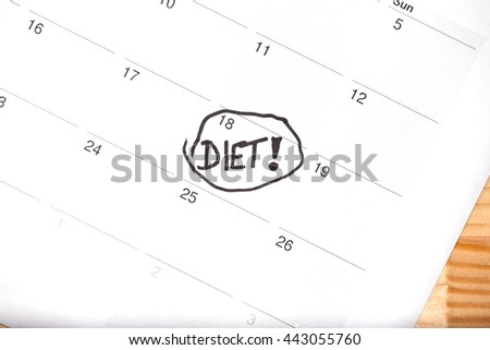 Diet start white calendar light natural wooden background