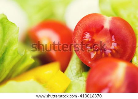 diet, vegetable food, healthy eating and objects concept - close up of ripe cut vegetables in salad - stock photo