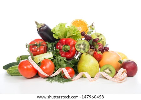 Diet weight loss breakfast concept with tape measure organic green apple, egg plant, orange, tomatoes, cucumbers, parsley, kiwi, grapefruit, salad, pearch, cherries on a white background - stock photo