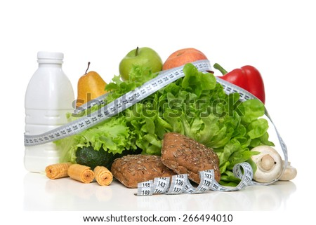 Diet weight loss breakfast concept with tape measure organic green apple salad bananas kiwi mashrooms avocado bottle kefir or milk pear on a white background - stock photo