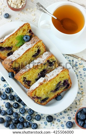 Dietary cake with oat flakes, cheese and blueberries - stock photo