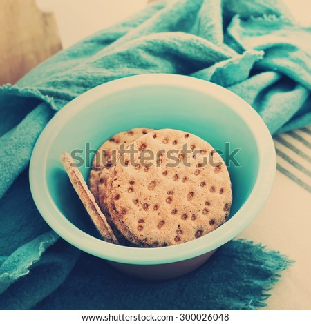 Dietary Cookies in Bowl on a chair with cozy plaid. Toning