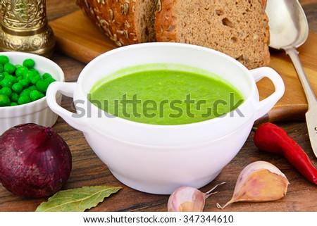 Dietary Soup Cream Puree of Green Peas Studio Photo - stock photo