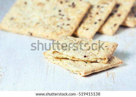 dietary whole grain crispbread, with whole grain seeds, healthy eating. Selective focus