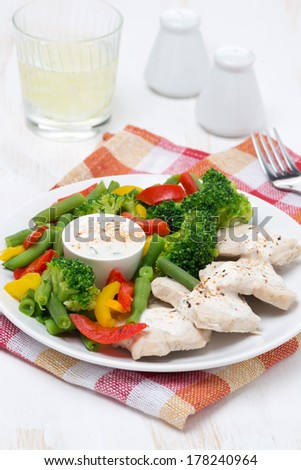 dietetic food - chicken fillet, steamed vegetables and yoghurt sauce, vertical