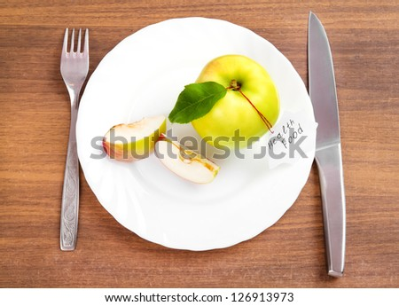 dieting and health food. Yellow, green apple with leaf and white sticker