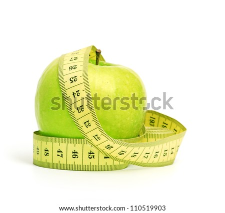 dieting. apple and tape isolated on a white background