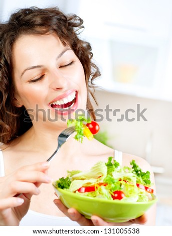 Dieting concept. Healthy Food. Diet. Beautiful Young Woman Eating Vegetable Salad. Vegetarian Food
