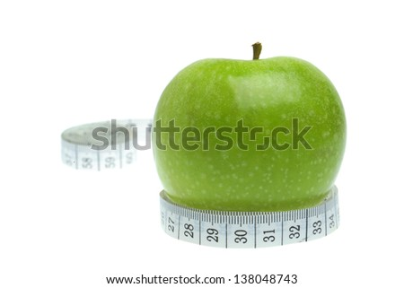 Dieting  concept - measurement and apple fruit