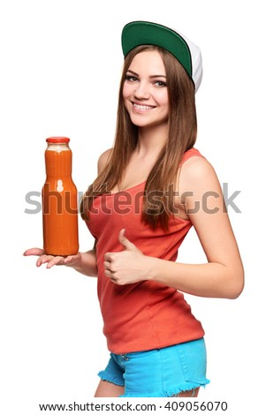Dieting, healthy eating, detox juice cocktail. Happy teen girl holding a bottle of vegetable juice and gesturing thumb up, over white background - stock photo
