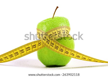 dieting, lose weight concept. apple with measuring tape - stock photo