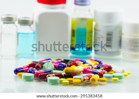 diferent Tablets pills capsule heap mix isolated on white background - stock photo