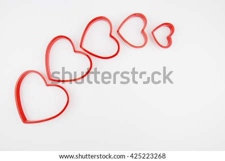 Difference sizes of hearts on white background, valentines concept