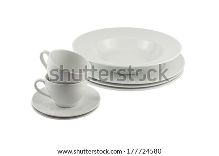 Differend stacked Plates Cups and saucers isolated on white backgound