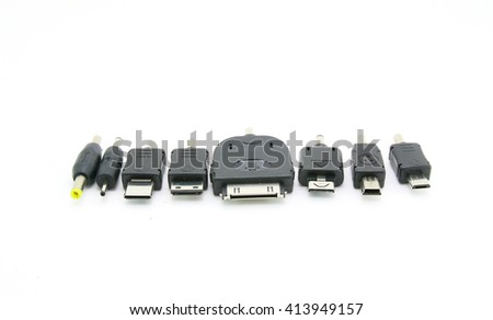 Different adapters for charger on white background