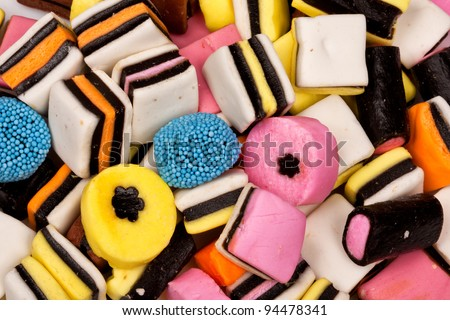 Different all sorts sweets in a pile with different shapes, sizes and colors