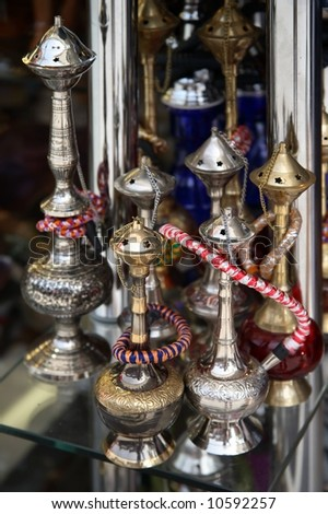 Different arabic hookahs in the market - stock photo