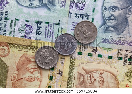 Different banknotes and coins  of Indian Rupee - stock photo