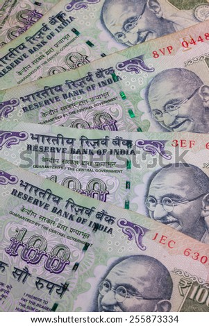 Different banknotes from India on the desk - stock photo