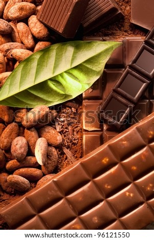 Different bars of chocolate on powdered cocoa. - stock photo