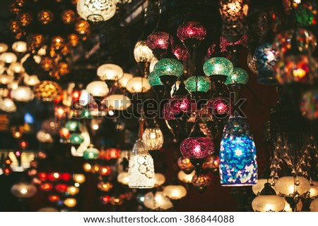 different beautiful Turkish-style lamps on the market - stock photo