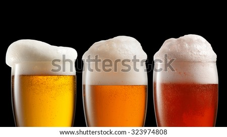 Different beer in glasses isolated on black background. Header for website - stock photo