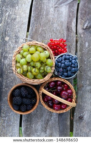 different berries on wooden table - stock photo