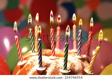 different birthday wishes inside flames on cake - stock photo