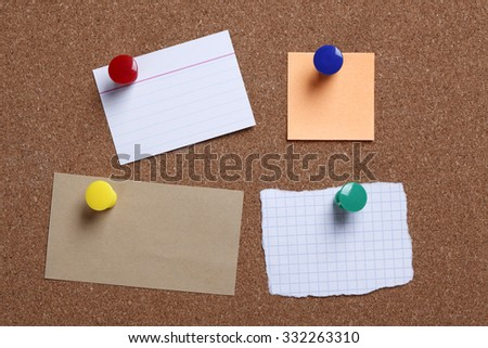 Different blank notes on cork message board