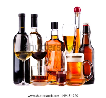 different bottles and glasses of alcoholic drinks isolated on a white background - stock photo