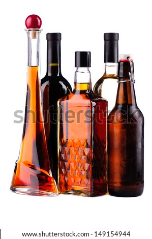 Different bottles of alcohol isolated on a white background - stock photo