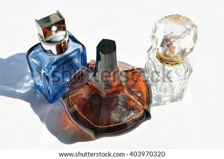Different bottles of perfumes - stock photo