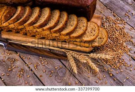 Different bread and bread slices. Food background. - stock photo