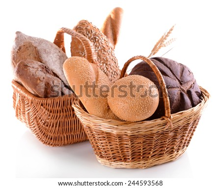 Different bread in wicker baskets isolated on white - stock photo