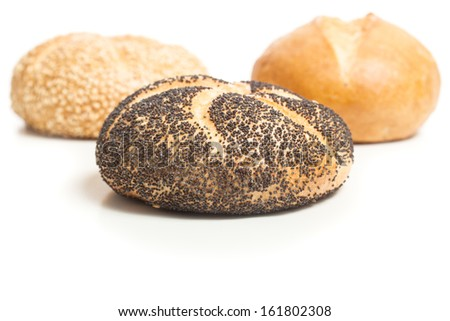 Different bread rolls, natural, covered with sesame and with poppy seeds, typical German breakfast food. Studio shot, cutout, isolated on white background.