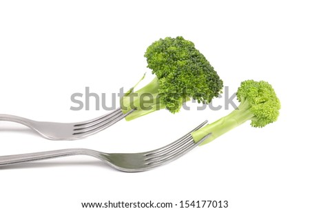 Different broccolies on two forks. White background.