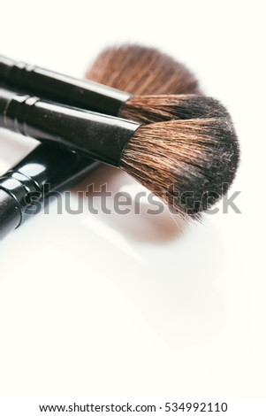 different brushes for make-up on a white background.