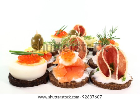 different canapes on a white background - stock photo