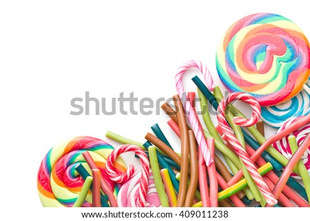Different candies. Gummy sticks and various lollipops isolated on white background. Top view.