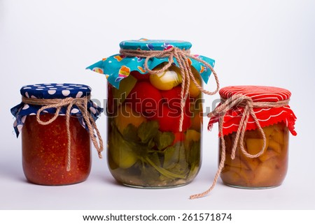 Different canning fruits and vegetables in bright design - stock photo