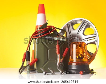 different car accessories including fuel can and road assistance light - stock photo