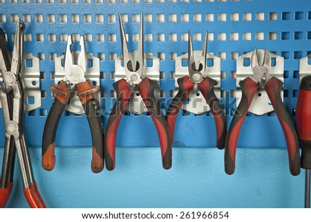 Different Car repair tools set on the wall - stock photo