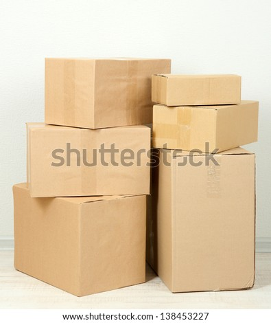 Different cardboard boxes in room