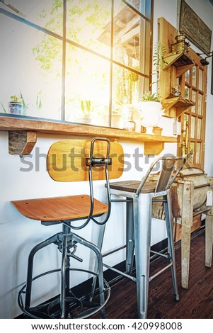 Different chairs in the cafe, retro and hipster style. - stock photo