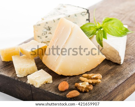 different cheese on a wooden board