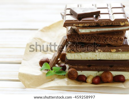 different chocolate bars - white, milk, black and nuts